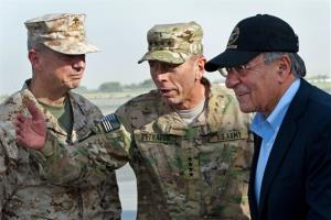 USMC Gen. John Allen, left, Army Gen. David Petraeus, and Defense Secretary Leon Panetta in Kabul, Afghanistan, in this July 2011 file photo.