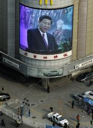 A mall screen shows the Chinese Communist Party's new general secretary Xi Jinping speaking at a press conference in Beijing Thursday, Nov. 15, 2012.
