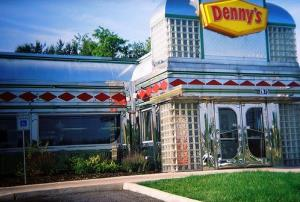 Denny's franchisee may start charging customers to help pay for increased healthcare costs.