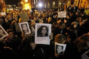 Protesters gather outside Leinster House in Dublin  Wednesday, hoping posters of Savita Halappanavar.