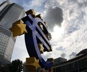 In this July 31, 2012 file photo the euro sculpture stands in front of the headquarters of the European Central Bank, ECB, in Frankfurt, Germany.