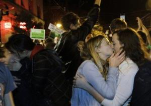 Revelers kiss as they celebrate early election returns on a referendum in Washington state to legalize gay marriage.