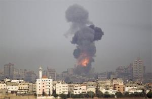 Smoke rises following an Israeli strike in Gaza on Saturday.