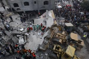 Palestinian firefighters work at the scene of an Israeli air strike on a building in the Jebaliya refugee camp in the northern Gaza Strip, Saturday, Nov. 17, 2012.