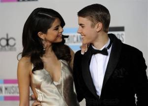 In this Nov. 20, 2011 file photo, Selena Gomez, left, and Justin Bieber arrive at the 39th Annual American Music Awards in Los Angeles.