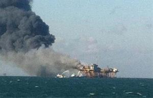 In this image released by a oil field worker and obtained by the AP, a fire burns on a Gulf oil platform Nov. 16, 2012, after an explosion on the rig, in the Gulf of Mexico off the Louisiana coast.