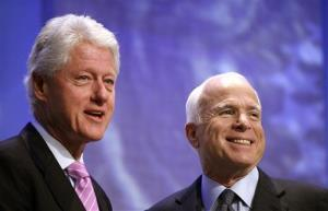 John McCain acknowledges the audience with former President Bill Clinton after delivering remarks at the Clinton Global Initiative annual meeting Thursday, Sept 25, 2008 in New York.