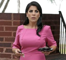 In this Nov. 13, 2012, file photo, Jill Kelley leaves her home in Tampa, Fla.