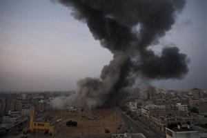 Smoke rises after an Israeli strike in Gaza City, Monday, Nov. 19, 2012.