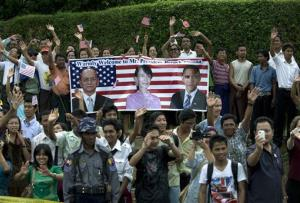 The crowd cheers as President Obama arrives at opposition leader Aung San Suu Kyi's residence in Myanmar today.