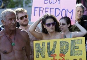 Demonstrators gather outside of City Hall in San Francisco for a protest against a proposed city-wide nudity ban.