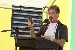 In this Thursday Nov. 8, 2012, photo, John McAfee speaks at the official presentation of equipment ceremony that took place at the San Pedro Police Station in Ambergris Caye, Belize.