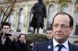 French President Francois Hollande leaves after laying a wreath during the ceremony marking Armistice Day in Paris, Sunday Nov. 11, 2012.