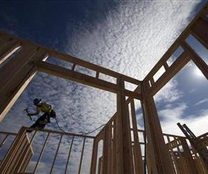 Construction worker Elabert Salazar works on a house frame for a new home Friday, Nov. 16, 2012, in Chula Vista, Calif.