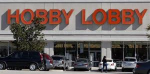 Customers walk to a Hobby Lobby store in Dallas on Thursday, Nov. 1, 2012.