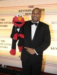 Elmo and Kevin Clash arrive at the Kennedy Center for the Performing Arts for the Kennedy Center Honors gala performance on Sunday, Dec. 4, 2011 in Washington.