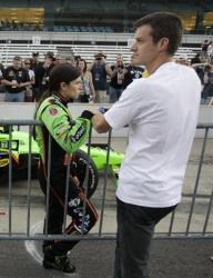 In this 2011, file photo, Danica Patrick and husband Paul Hospenthal wait for her turn to qualify at the Indianapolis Motor Speedway.