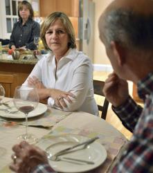In this photo taken Nov. 16, 2012, Anne Brennan, center, of Hingham Mass., listens to her sister, Linda Marshall, rear, and brother-in-law Steve Marshall, right, discuss the recent presidential election.
