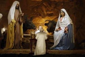 Pope Benedict XVI prays at the nativity scene at St. Peter's Basilica at the Vatican in 2009. According to him, that cow and donkey shouldn't really be there.