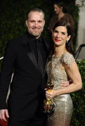 In this March 7, 2010 file photo, Sandra Bullock and Jesse James arrive at the Vanity Fair Oscar party in West Hollywood, Calif.