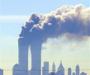 Smoke billows from the twin towers of the World Trade Center in New York after planes crashed into each tower in this Sept. 11, 2001 file photo.