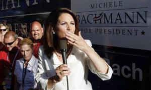 Rep. Michele Bachmann, R-Minn., blows kisses as she speaks to her supporters after winning the Iowa straw poll in Ames on Aug. 13, 2011.