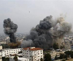 Smoke raises as another missile approaches the target during an Israeli air strike in Gaza City, Wednesday, Nov. 21, 2012.