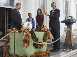 President Obama, with daughters Sasha and Malia, pardons Liberty the turkey last year.