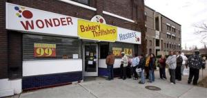 People wait in line to get into the Hostess Thrift Shop in Ogden, Utah on Friday.
