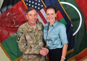 Gen. Davis Petraeus, left, shakes hands with Paula Broadwell, co-author of his biography All In: The Education of General David Petraeus.