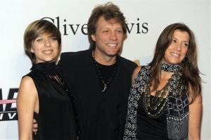 Jon Bon Jovi, center, with daughter Stephanie Rose Bon Jovi, left, and wife Dorothea Rose Hurley arrive at the annual Pre-GRAMMY Gala on Saturday, Jan. 30, 2010.