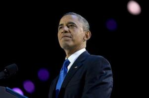 Barack Obama pauses as he speaks at the election night party at McCormick Place, in Chicago.