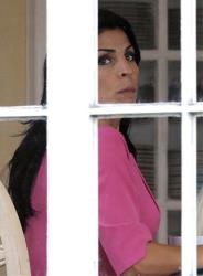 Jill Kelley looks out the window of her home Tuesday, Nov 13, 2012 in Tampa, Fla.