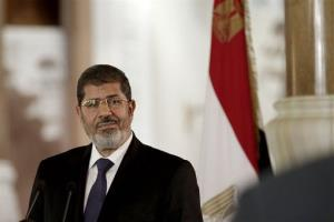 In this Friday, July 13, 2012 photo, Egyptian President Mohammed Morsi speaks to reporters during a news conference at the Presidential palace in Cairo, Egypt.