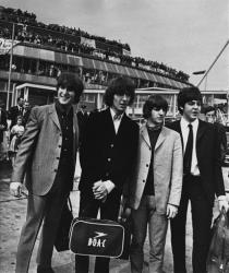 In this Aug. 13, 1965 file photo The Beatles, with John Lennon, George Harrison,Ringo Starr and  Paul McCartney, from left to right stand at the airport in London.