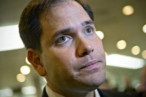 Sen. Marco Rubio speaks to reporters after leaving a closed-door meeting at the Capitol in Washington, Tuesday, Nov. 13, 2012.