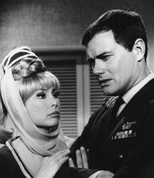 This 1967 file photo shows Barbara Eden, left, and Larry Hagman in a scene from the television show I Dream of Jeannie.