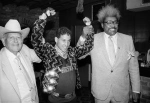 In this 1986 file photo, Hector Macho Camacho, WBC lightweight boxing champion, is escorted by Marty Cohen, left, and boxing promoter Don King during a news conference in New York.