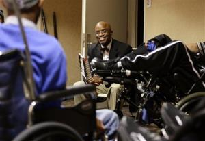 This photo taken Nov. 20 shows Dr. Samuel Gordon during a group support session for gunshot survivors in Washington.
