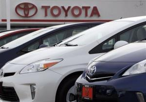 This Feb. 19 file photo shows a line of 2012 Prius sedans at a Toyota dealership in the south Denver suburb of Littleton, Colo.