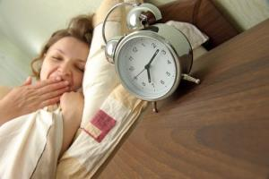 A woman wakes up, but did she get enough sleep?