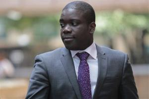 Former trader Kweku Adoboli leaves Southwark Crown Court in London .