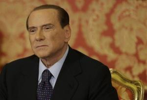 Silvio Berlusconi grimaces during a press conference in Gerno, near Milan, Saturday, Oct. 27, 2012.