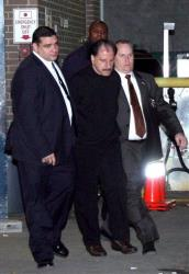 In this Nov. 21, 2012 photo provided by VosIzNeias.com, police escort Salvatore Perrone, center, from New York's the 67th Precinct.