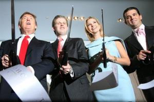 Donald Trump, left, chairman and CEO of the Trump Organization, cuts the ribbon with his children Eric, Ivanka, and Donald Trump, Jr. right, at the opening of the Trump SoHo New York, April 9, 2010.