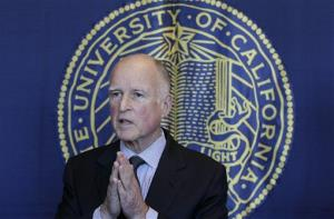 Gov. Jerry Brown speaks to reporters after attending a University of California Board of Regents meeting in San Francisco, Wednesday, Nov. 14, 2012.