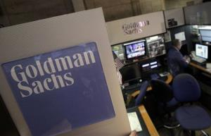 In a March 15, 2012 file photo a trader works in the Goldman Sachs booth on the floor of the New York Stock Exchange.