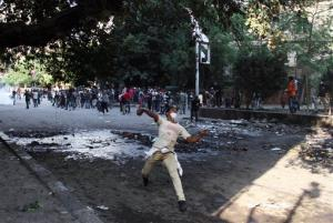Egyptian protesters clash with security forces, not pictured, near Tahrir Square in Cairo, Egypt, Sunday, Nov. 25, 2012.