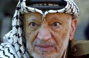 In this Saturday, Oct. 2, 2004 photo, Palestinian leader Yasser Arafat is seen at his compound in the West Bank town of Ramallah. He died the following month.