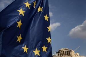 A European Union flag billows in the wind in front of the ruins of Parthenon temple in Athens yesterday.